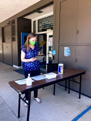 Ashley Wooldridge, a preschool teacher, manages the check-in table at Marindale Preschool in San Rafael.