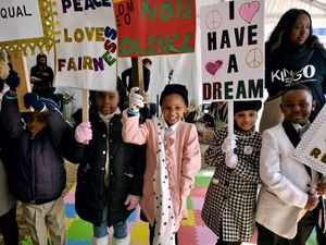 Melissa Collins' students march in a MLK Day parade.