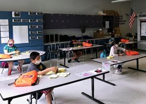Students in Meriden work on classwork at summer school.