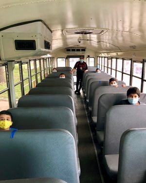 Students ride the bus in Premont, Texas.