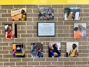 Student photography displayed on a classroom wall
