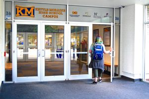 A student walks into Kettle Moraine High School.