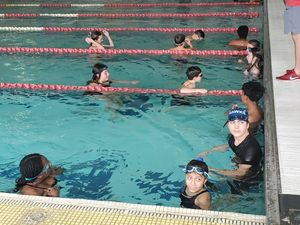 Westdale middle school swim team swimming at championship meet
