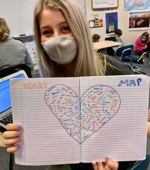 A student in Allison Berryhill's class holds up her heart map.