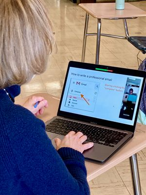 An OT shows students how to prepare an email.