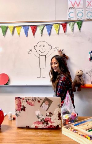 Monica Keyser models a drawing for students on Zoom.
