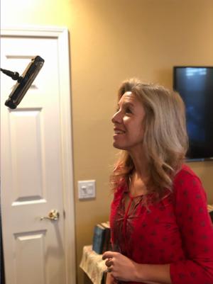 Winnie Sloan makes a TikTok video.