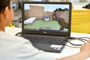 Photo of boy playing Minecraft game