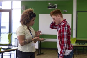 Student and teacher having a serious discussion