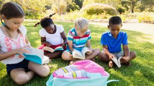 Kids reading in the park