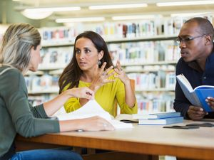 Teachers working together in a library