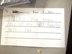 "A note from one young student in the writer's class to another that says, ""I like you because you let me play family with you."""
