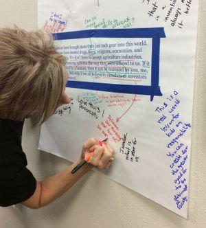 photograph of a teacher writing on a collaborative document