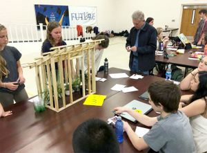 Students participate in a mock trial at their school.