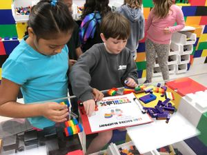 Students in a makerspace with Legos everywhere