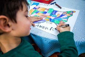 Child coloring a map of the U.S.