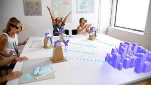 Students look at 3-D renderings of windmills.