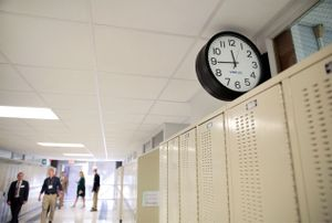 Tour guests walk the hallways of West Leyden High School.