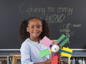 Young student with her homemade windmill project
