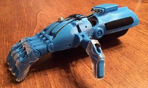 A blue, prosthetic hand that looks like a robot's hand.