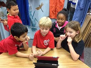Young Students Using a Tablet