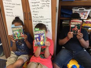 Children reading graphic novels