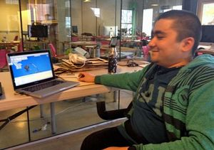 Sayed showing designs at his computer