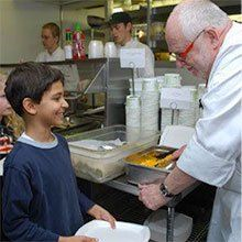 "A photo of chef Robert ""Bobo"" talking with a young student."