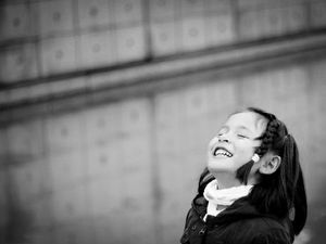 Black and white photo of a child smiling brightly