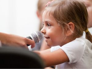 Young student with a microphone
