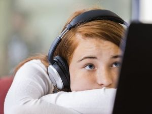 Unengaged student with headphones