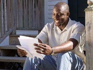 Parent Reading a Letter