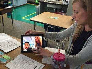 Teacher watching herself on video