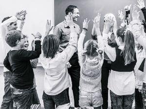 Happy Students Around a Teacher