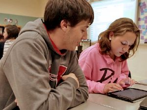 Students Looking at a Tablet