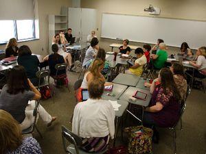 Teachers Sitting in Classroom Talking