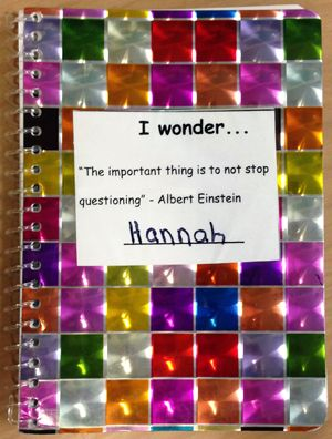 "Hannah's colorful sparkly journal with a cover sticker that says, I wonder . . . ""The important thing is to not stop questioning"" --Albert Einstein, and then a line for the student's name"