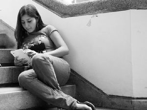 A student reading on a tablet