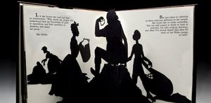 An opened pop-up book showing black silhouettes of four people working