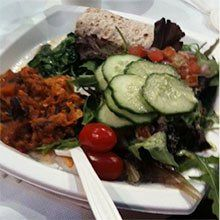 A photo of a salad with colorful side dishes.