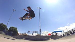 Skateboarder catches air