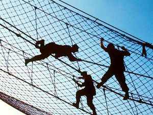 men silhouetted in netting