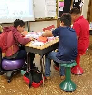 Students sit on balance balls and active learning stools in class.