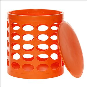 An orange storage bin