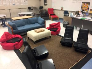 A classroom with flexible seating, like bean bag chairs and a couch.