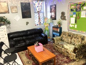 A lounge area in a classroom with couches and a coffee table