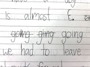 A sample of student work in pen from the writer's class, showing a misspelled word crossed out and corrected
