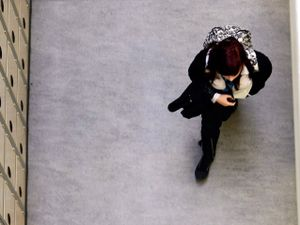 Overhead view of a student walking down a hallway