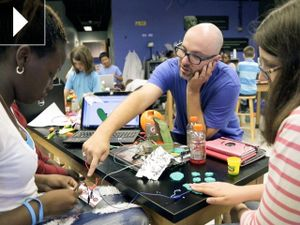 Jay Silver helps students create with the Makey Makey kit.