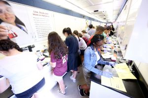 Students are working inside of a semi-truck that was converted into a science lab.